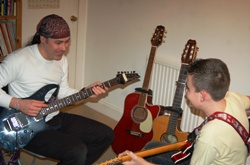 Martyn with guitar student