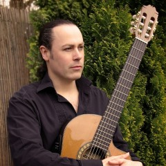 Martyn holding an acoustic guitar