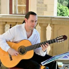 Playing traditional Spanish guitar at a private function